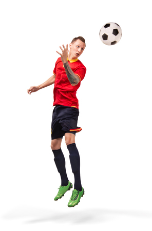 football player hitting the ball with head isolated on white 스톡 콘텐츠