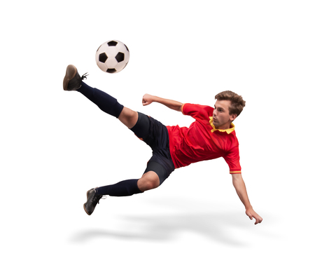 soccer player kicking the ball in the air isolated on white 스톡 콘텐츠