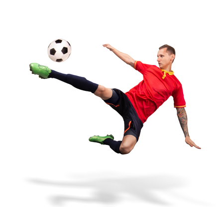 soccer player kicking the ball in the air isolated on white 스톡 콘텐츠 - 114596120