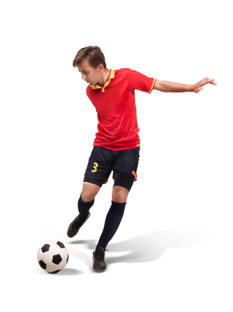 soccer player kicking the ball in the isolated on white
