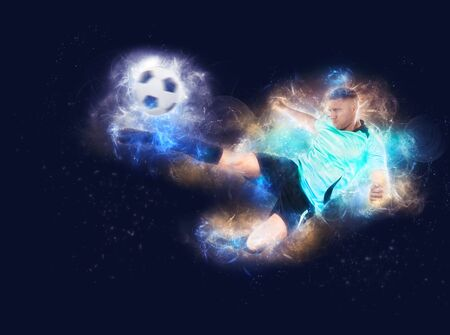 soccer player in fire kicking the ball in the air isolated