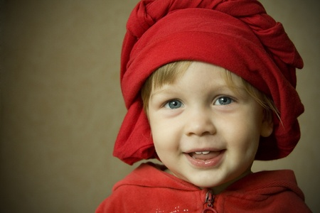 portrait of a child in red on a background photo