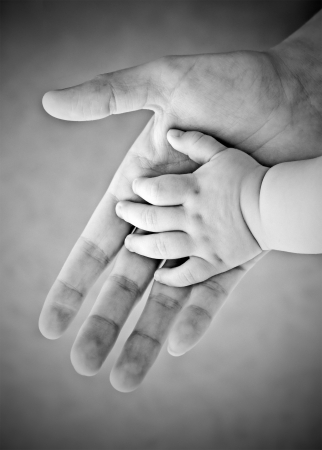 hands of the child and adult photo