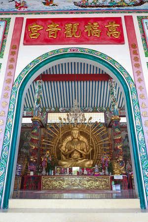 Golden Kuan Yin Statue in Temple photo
