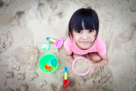 Girl Making Sand on the Beach Stock Photo - 10699644