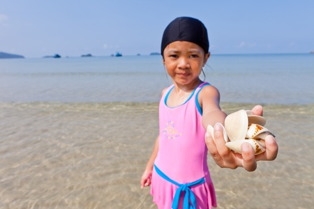 Little cute girl on the beach Stock Photo - 10745818