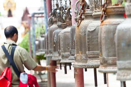 Old bells in a buddhist temple of Thailand photo