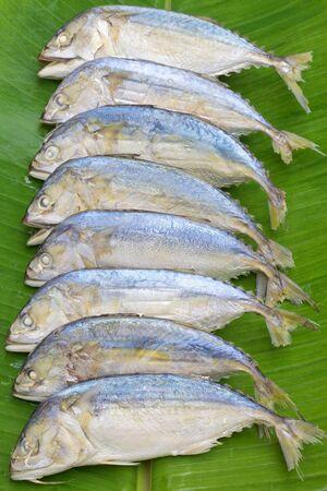 Steamed Mackerel on banana leaf photo