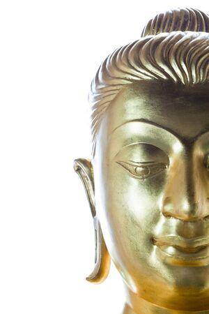 Half face of buddha statue isolated on white background photo