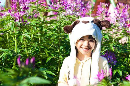 Happy Smiling Girl with Wild Flowers photo