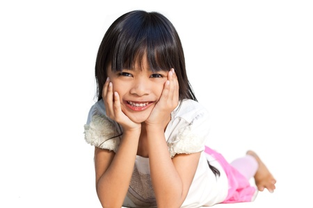 Smiling little girl isolated on white background photo
