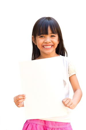 holding a sign: Smiling little girl holding empty white board Stock Photo