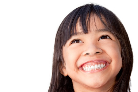 laughter: Happy little girl isolated on white