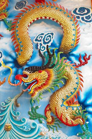 china dragon: Dragon sculpture on wall of temple in Thailand