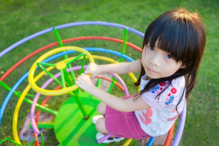 Cute little girl enjoys playing in a children photo