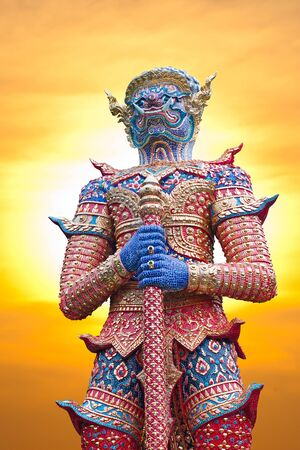 thai believe: Giant at thailand temple with sunset Stock Photo