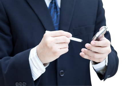 Business man using a mobile phone isolated on white photo