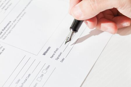 Human hand with pen makes signature Stock Photo - 11962279