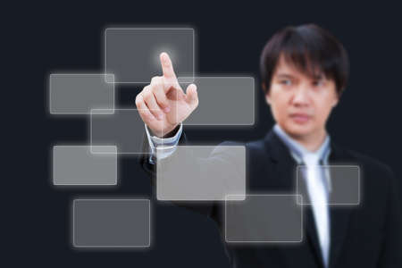 Asian business man pushing button on the whiteboard Stock Photo - 11962276