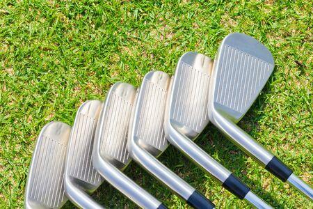 golf stick: Golf Equipments on green grass Stock Photo