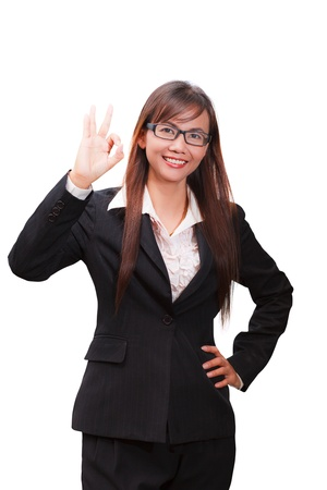 Business woman showing OK hand sign smiling happy photo
