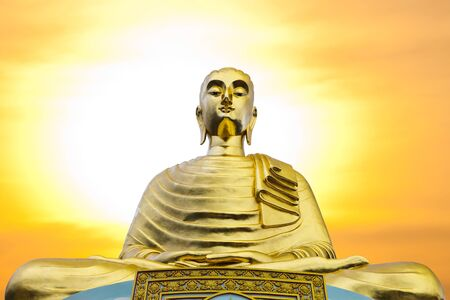idolatry: Big buddha Statue with Sunset in temple,Thailand