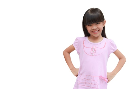 hands on waist: Smiling little girl standing with hands on waist