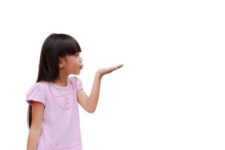 extends: Little girl blows with an empty hand, isolated on white Stock Photo