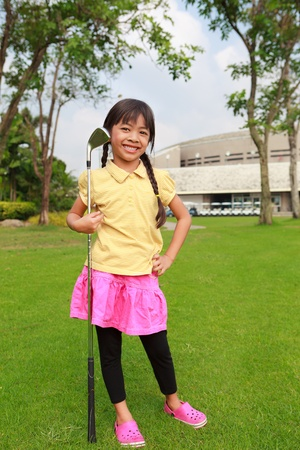 Little girl at golf club photo