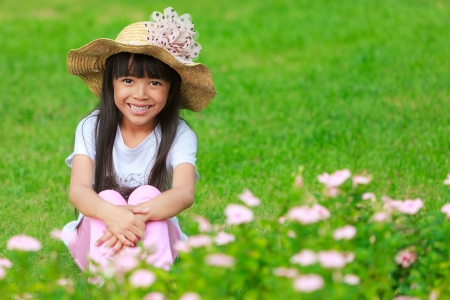 Smiling little girl on the meadow photo