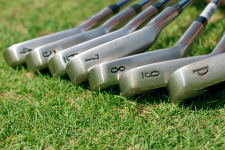 Golf club laying on green grass Stock Photo - 12427945