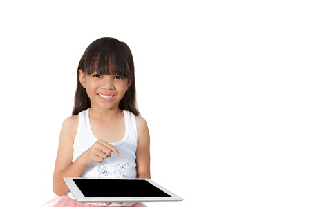 Little girl with touch pad computer, Isolated on white photo