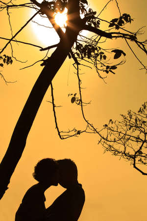 Silhouette a young couple embracing photo