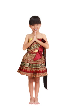 costume jewelry: Thai littile girl dressing with traditional style, Isolated on white Stock Photo