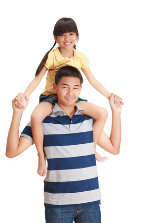 Young sister hold on her big brother Stock Photo