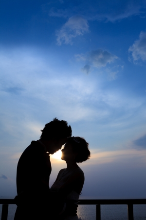 black couple: Sunset silhouette a young couple embracing