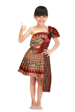 Little thai girl smiling and showing thumb up isolated on white Stock Photo - 12995541