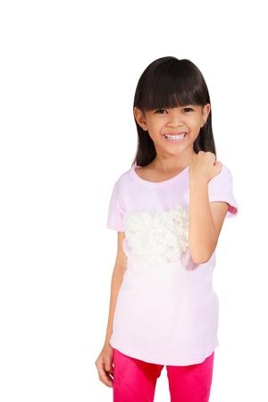 mujer hijos: Ni�a sonriente estar satisfecho por la victoria de un gesto, aislado en blanco