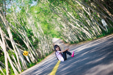 long road: smiling little girl on the road