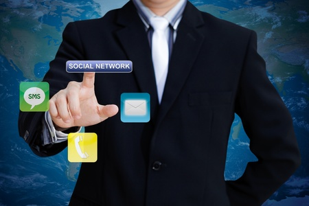 Businessman pushing social network icon for communication Stock Photo - 13245094