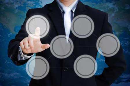 Hand of businessman pressing on a touch screen interface Stock Photo - 13245090