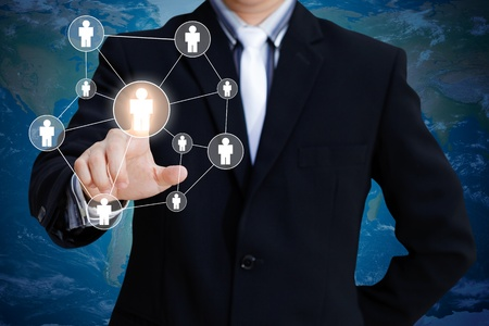 social relation: Businessman pressing modern social buttons on a virtual background Stock Photo