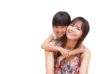 Mother and her little daughter embracing, Isolated on white photo