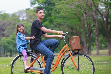 Brother and syster cycling bicycle at the park photo