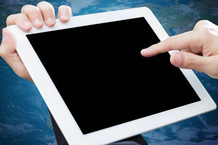 Person hand holds and touch tablet computer Stock Photo - 13283476