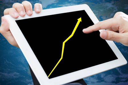 Business chart on a touch screen tablet photo