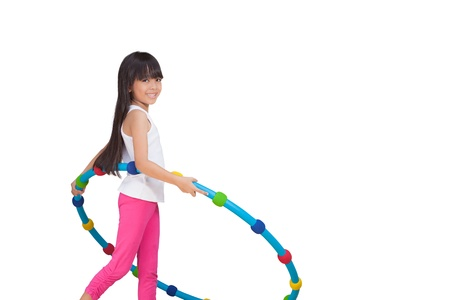 little girl barefoot: Little girl with hula hoop, Isolated on white Stock Photo