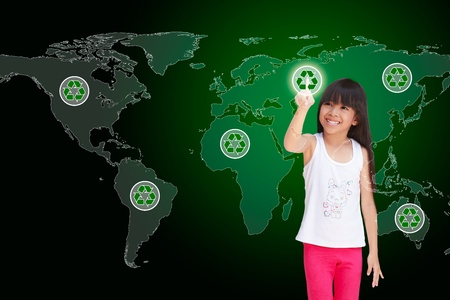 Little girl pressing recycle icon on world map Stock Photo - 13283482