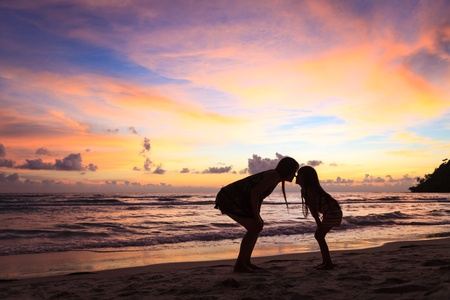 Silhouette mother with daughter ashore on sunset Stock Photo - 13373512
