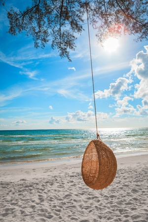 Rattan swing at the beach Stock Photo - 13373581
